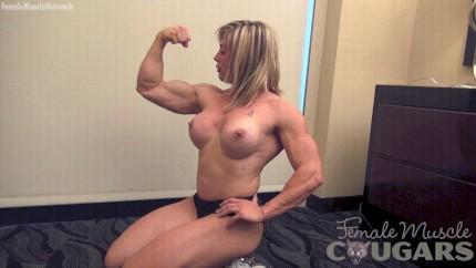 Ebony female bodybuilder flexing and toying 7